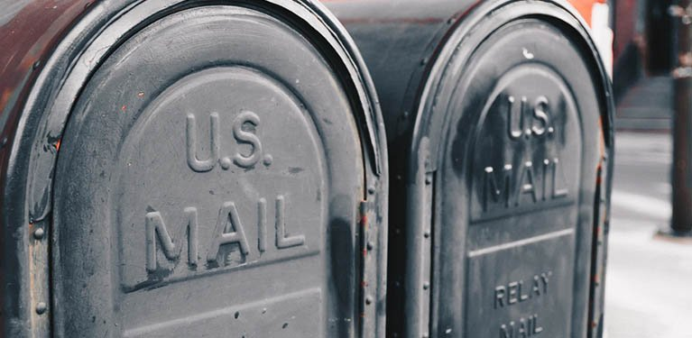 Two old-fashioned mailboxes